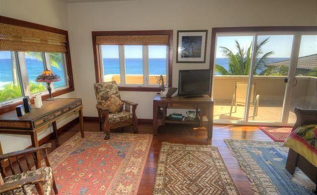 Breakwater - Bedroom with sitting area and patio- Poipu Kauai Vacation Home