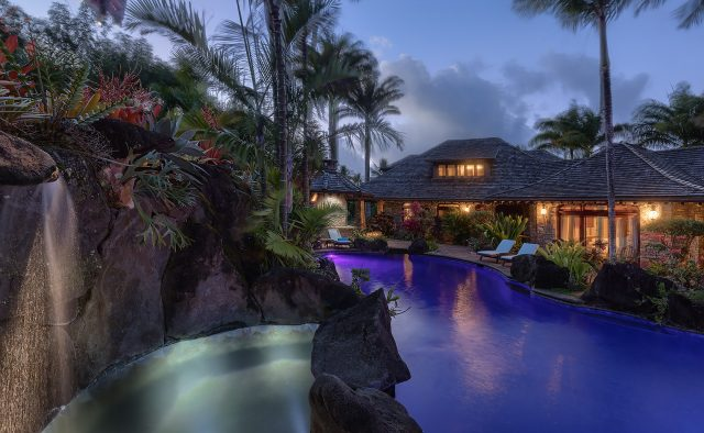Enchanting Meadow - Pool with waterfall lit up - Hawaii Vacation Home