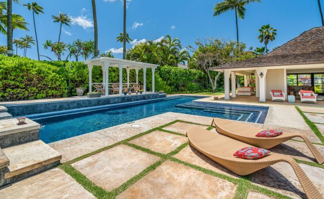 Coral Reef - Pool and lounge chairs at daytime - Oahu Vacation Home