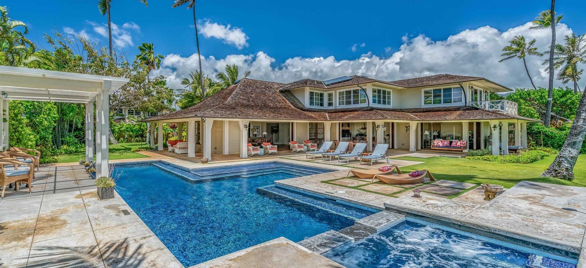 An image of the pool and back of the Coral Reef villa for rent